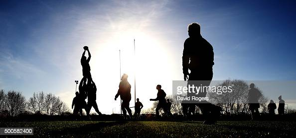 A silhouette of the Northampton Saints practicing their lineouts during the Northampton Saints training session held at Franklin's Gardens on...
