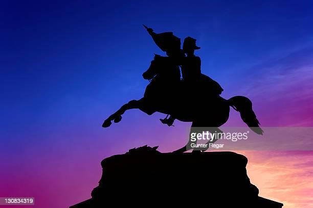 Silhouette of the rider's statue of Erzherzog Karl (archduke)on the Heldenplatz (heroes square) in Vienna, Austria