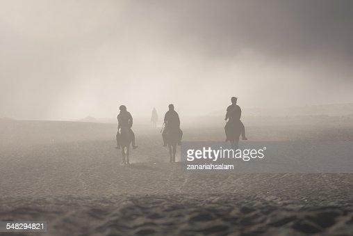 Silhouette of three people horse riding, Mount Bromo, East Java, Surabaya, Indonesia