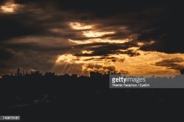Silhouette Of Trees Against Dramatic Sky