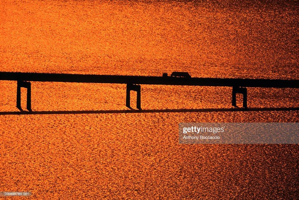 Silhouette of truck crossing bridge (gel effect) : Stock Photo