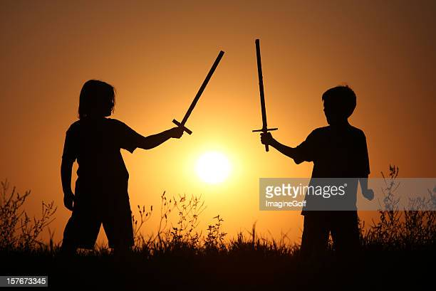 Silhouette of Two Children With Fantasy Swords