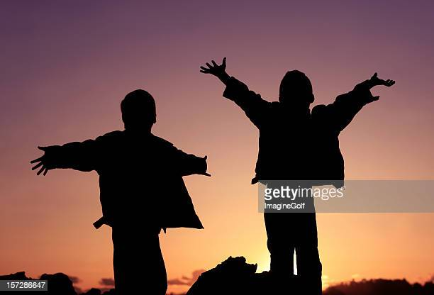 Silhouette of two Happy Elementary Children