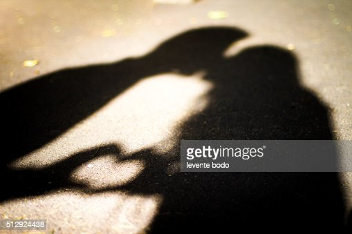 East Orange Focus >> Silhouette Of Two Lovers Kissing And Forming A Heart Shape ...