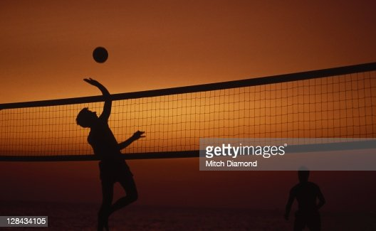 Silhouette Of Two Men Playing Volleyball Foto De Stock