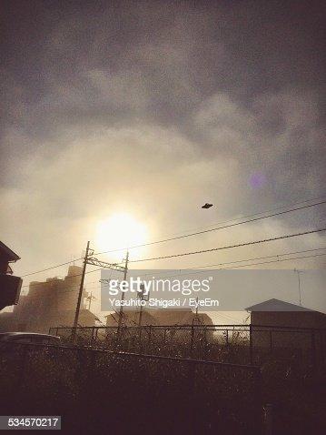 Silhouette Of Ufo In Sky At Sunset