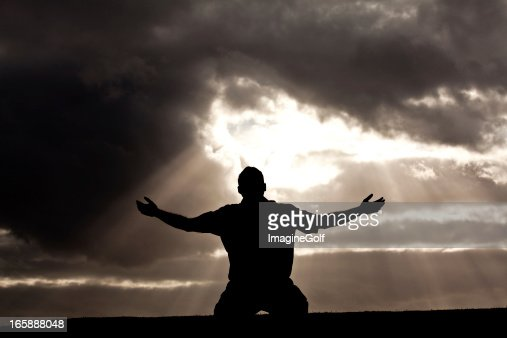 Silhouette of Unrecognizable Man in Worship Silhouette