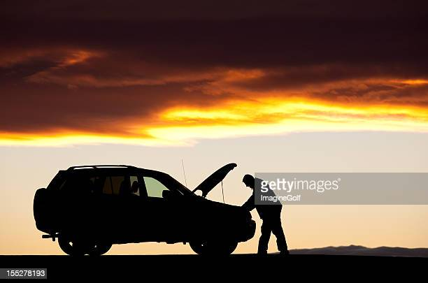 Silhouette of Unregnizable Adult Male Having Car Trouble