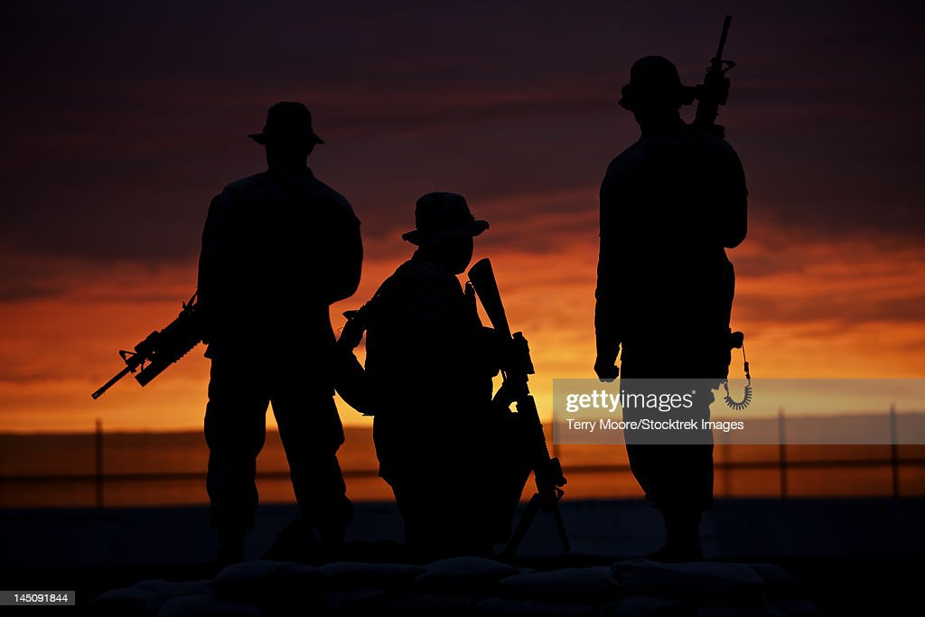 Silhouette of U.S Marines on a bunker at sunset in Northern Afghanistan.