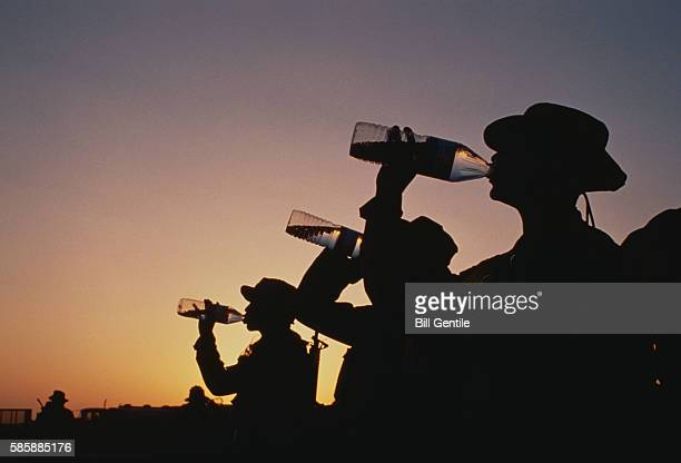 Silhouette of US Soldiers Drinking Water