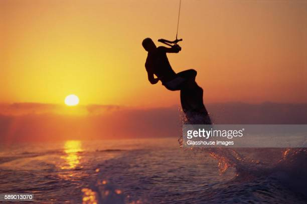 Silhouette of Wake Boarder in Air at Sunset