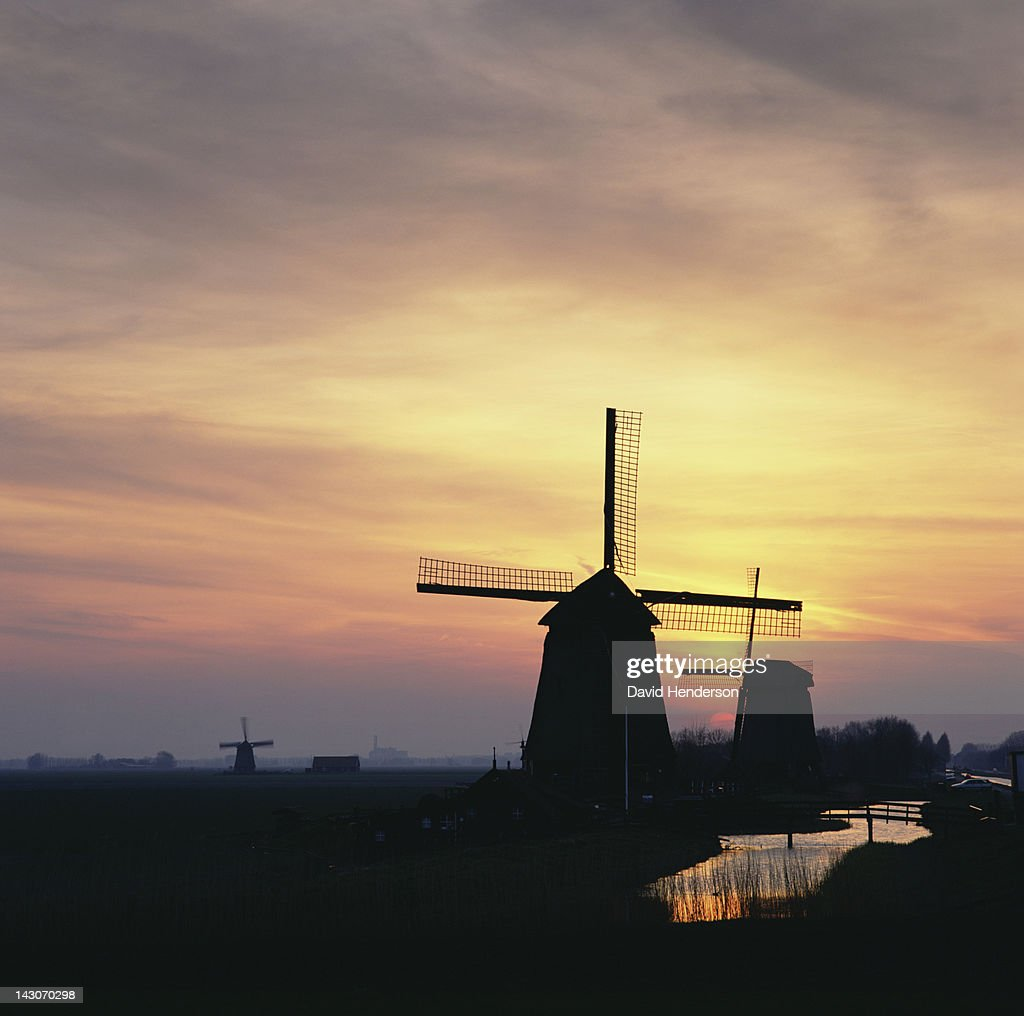 Silhouette of windmills in rural landscape : Stock Photo