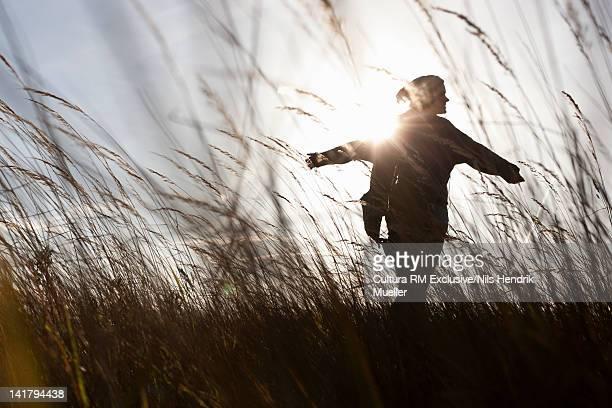 Silhouette of woman in wheatfield