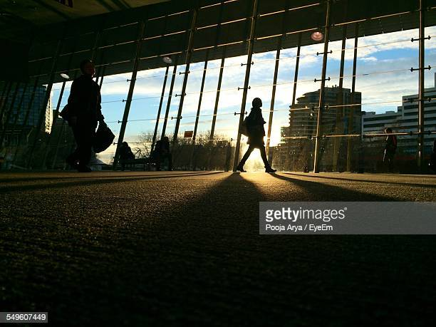 Silhouette Of Woman On Elevated Walkway