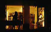Silhouette of woman on porch at night