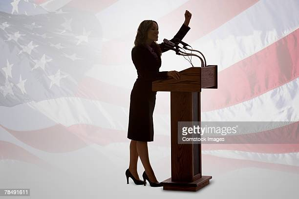 Silhouette of woman politician and American flag
