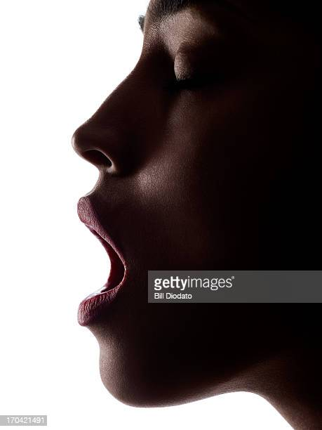 Silhouette of woman with open mouth