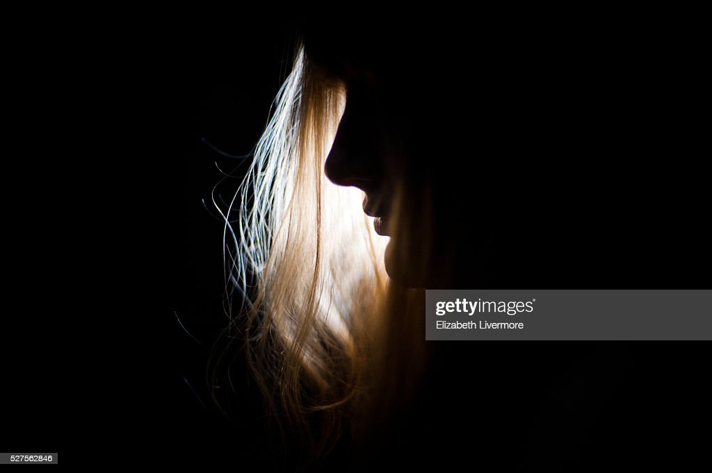 Silhouette of woman's face at night