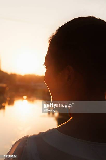 Silhouette of Woman's Face at Sunset
