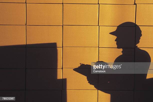 Silhouette of worker taking inventory