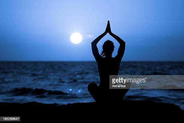 Silhouette of Young Woman Doing Yoga
