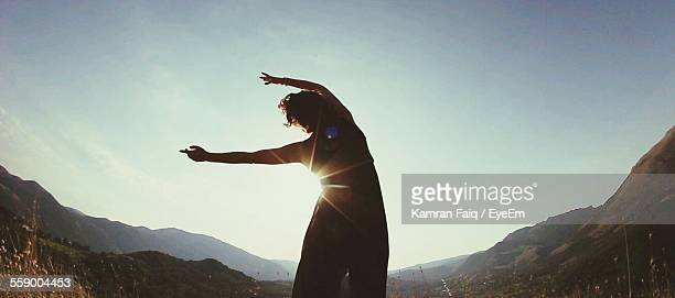Silhouette Of Young Woman Exercising