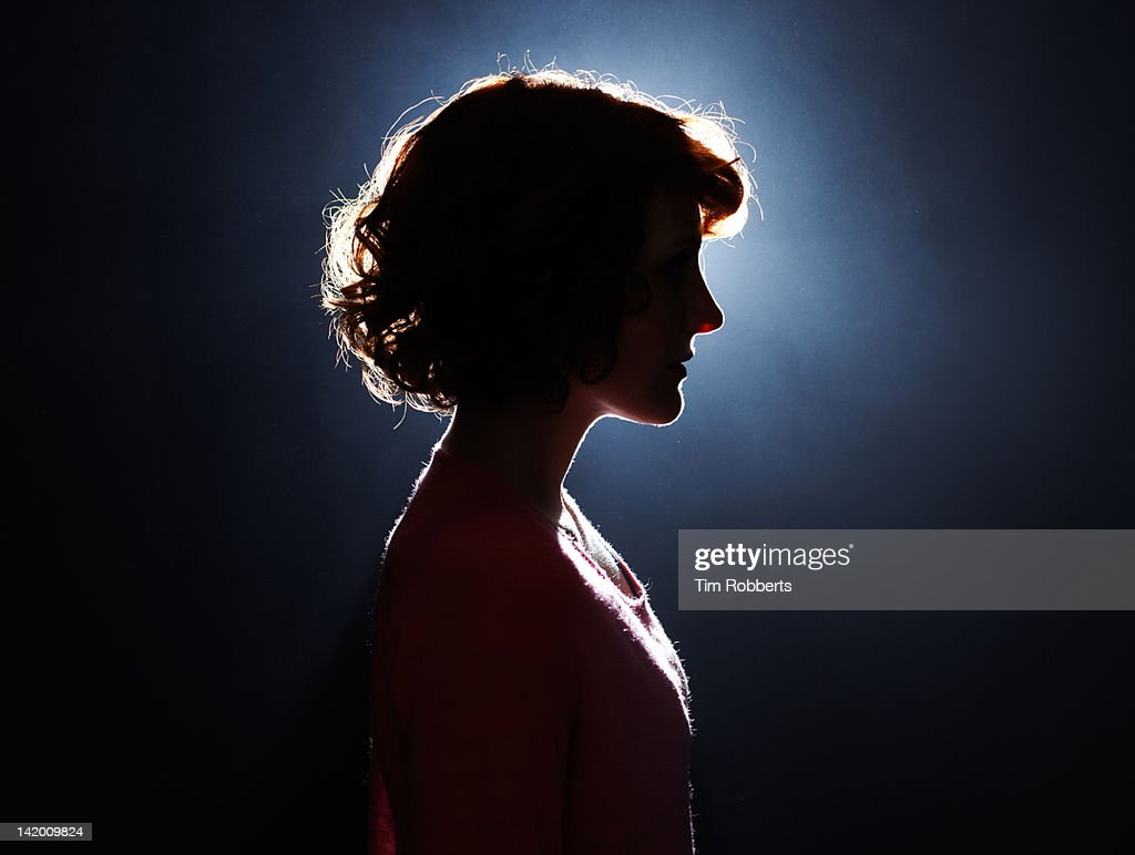 Silhouette of young woman.