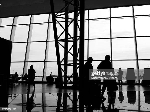 Silhouette People At Airport