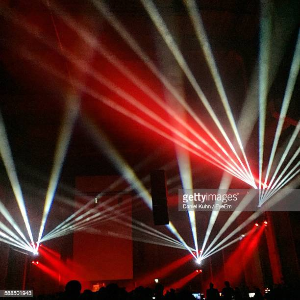 Silhouette People Below Illuminated Light Beams During Berlin Atonal