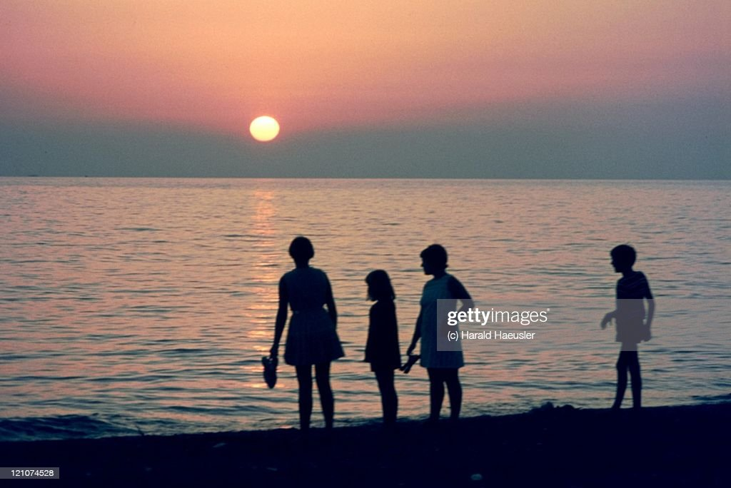Silhouette People On Beach At Sunset Italy Stock Photo ...