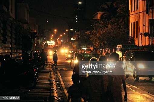 People Walking Night Stock Photos and Pictures   Getty Images