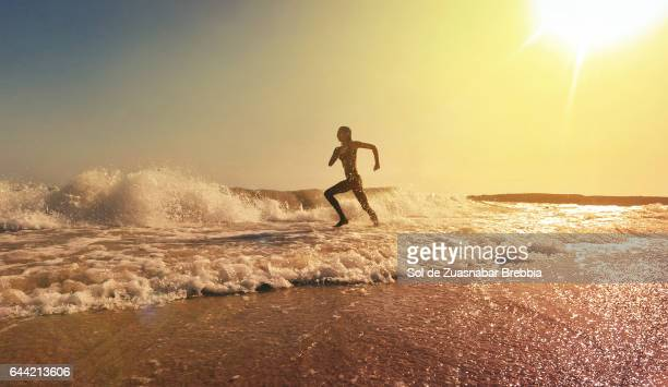 Silhouette running on the seashore at a beautiful sunset