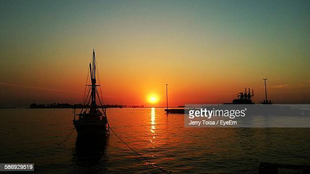 Silhouette Sailboats In Sea Against Clear Sky During Sunset