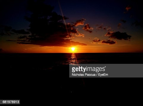 Silhouette Sea Against Sky During Sunset  Stock Photo
