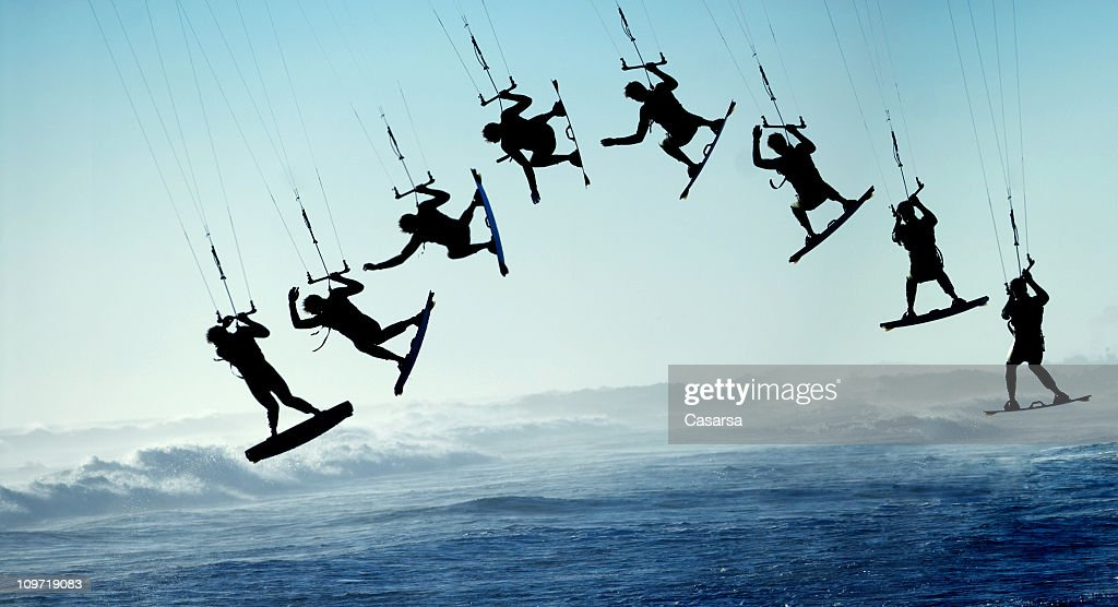 Silhouette Sequence of Surfing Kite Boarder Jumping