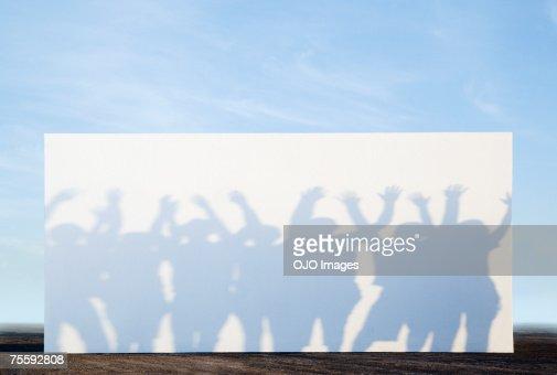 Silhouette shadows of people on a billboard : Bildbanksbilder