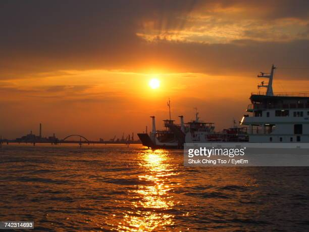Silhouette Ship In Harbor Against Sky During Sunset