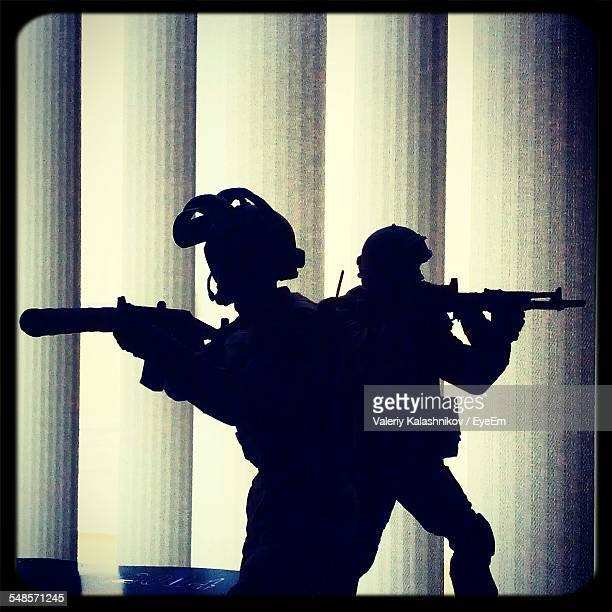 Silhouette Soldiers With Guns