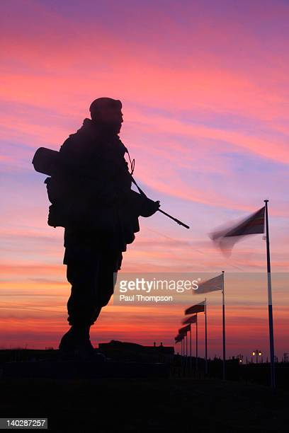 Silhouette statue of soldier at sunrise