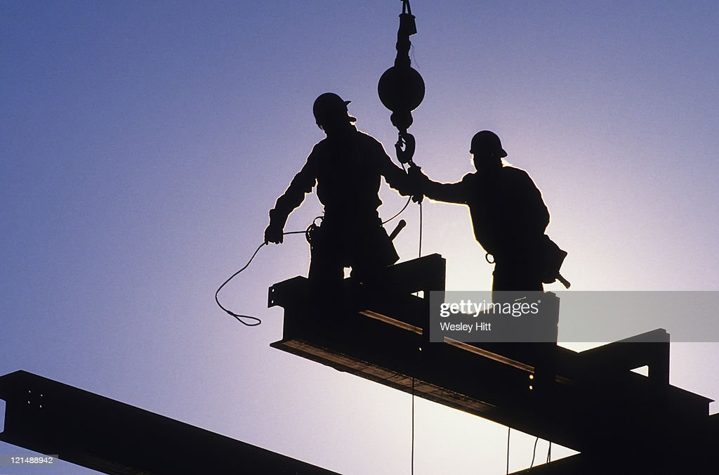 Silhouette steel workers : Stock Photo