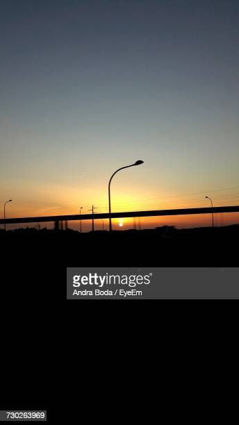 Silhouette Street Light Against Sky During Sunset