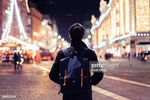 Silhouette walking in Christmas market