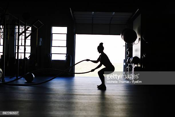 Silhouette Woman Exercising With Rope