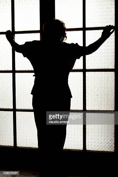Silhouette Woman in Front of Door. Color Image