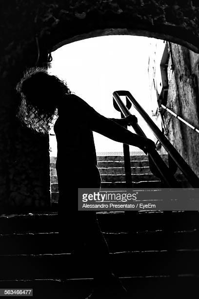 Silhouette Woman Standing On Stairs
