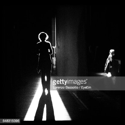 Silhouette Woman Walking In The Dark