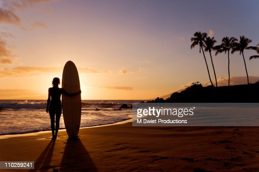 Silhouette woman with surfboard : Stock Photo