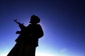A silhouetted Afghan soldier keeps vigil in the Arma mountains near Gardez where fighters for Osama bin Laden's terrorists alQaeda network and the...
