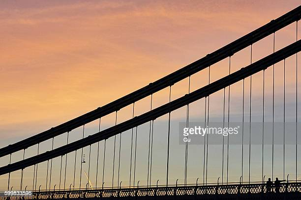 Silhouetted detail of Clifton suspension bridge at sunset, Bristol, UK