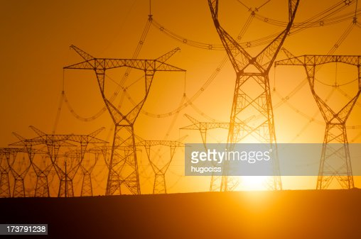 Silhouetted electricity pylon grid